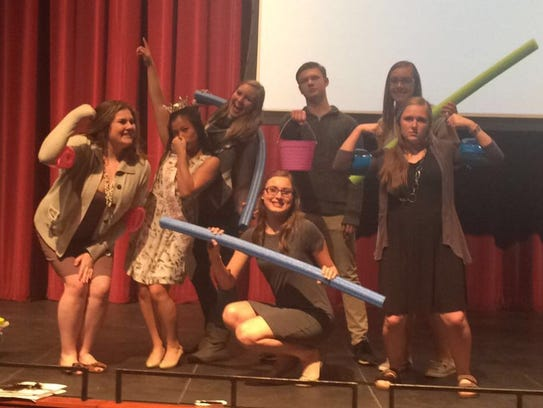 Mayor's Youth Council poses with pool toys at a public