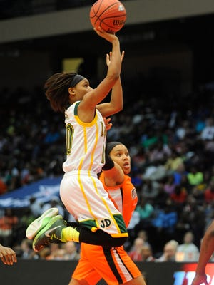 Jeff Davis' Ahyiona Wilson shoots against McGill-Toolen in the 7A State Championship Game at the AHSAA State Finals in Legacy Arena at the BJCC in Birmingham, Ala. on Saturday February 28, 2015.