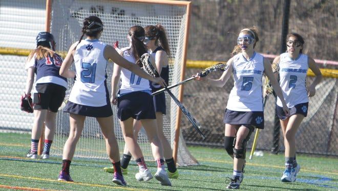 Ursuline celebrates after scoring a goal in the first half during a girls lacrosse game between Ursuline and Kennedy at the Ursuline School on Tuesday, April 19th, 2016. Ursuline won 18-10.