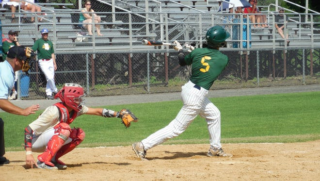 Burlington's Chris Fenimore delivers a single in Game 2 of Saturday's Twin State Baseball Classic in Concord, New Hampshire.