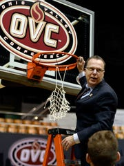 Jacksonville State head coach Ray Harper looks back at his players before cutting down the net after defeating Tennessee-Martin in an NCAA college basketball game for the championship of the Ohio Valley Conference basketball tournament Saturday, March 4, 2017, in Nashville, Tenn. (AP Photo/Mark Zaleski)