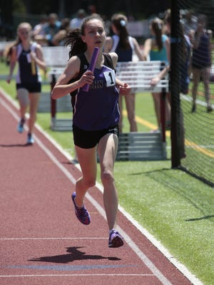 John Jay's Jemma Nuttall competes in the 4x1600m at the Eastern States track championship at Iona Preparatory School in New Rochelle on June 7, 2015.