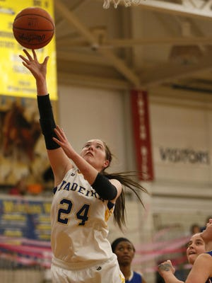 Madeira forward Jamie Grob (24) shoots a layup during the girls high school basketball game between Reading and Madeira, Thursday, Jan. 21.