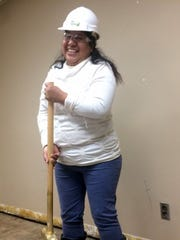 Rosa Ramirez reacts happily Friday, Dec. 16, 2016, after she swung a sledgehammer and put a hole in a wall that is being torn down in the basement of the Madison-Monroe Building for the renovation of classroom space for Literacy Green Bay. Ramirez, a Green Bay resident, is an adult learner at the downtown agency. The $189,000 renovation project, which is funded by private and corporate donors, is expected to be finished at the end of January.
