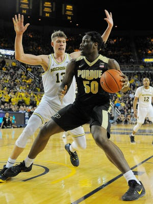 Michigan's Moritz Wagner defends against Purdue's Caleb Swanigan in the first half.