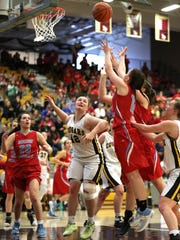 Cascade's Halle Wright and the Cougars fall to Seaside 47-42 in the OSAA Class 4A state quarterfinals on Thursday, March 9, 2017, at Forest Grove High School.