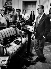 Gov. Lamar Alexander, right, holds a press conference Nov. 9, 1982, in his offices at the state Capitol.