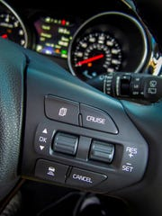 The Sedona SX Limited sports an instrument panel that includes adaptive cruise control.