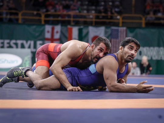 Joe Colon, left, scores points against India's Sandeep Tomar en route to a 6-4 decision win during the 2018 Wrestling World Cup in Iowa City on Saturday, April 7, 2018.