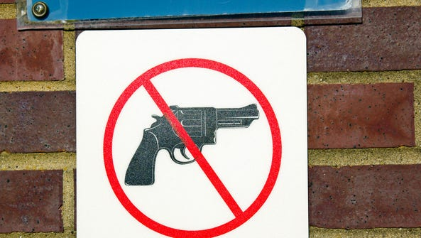 A no-guns sign on display.