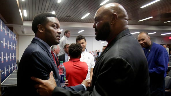 New UA head football coach Kevin Sumlin (left) greets