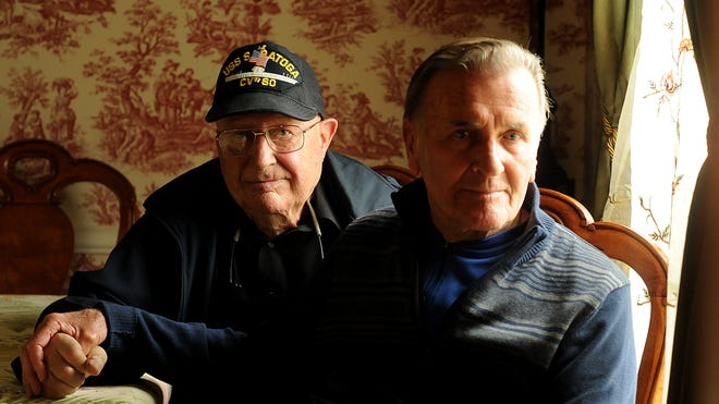 Orphaned brothers, John G. Holland Jr., 84, left, and Frank Holland, 83, searched for each other for 70 years.