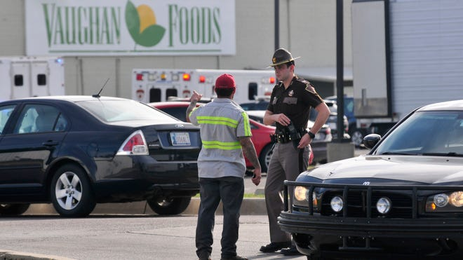 An Oklahoma State trooper help secure the scene at Vaughan Foods.