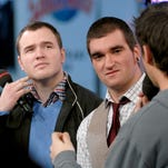 New Found Glory band members, singer Jordan Pundik, center and bassist Chad Gilbert, left, talk with VJ Damien Fahey, right, as they appear on MTV's Total Request Live at MTV Times Square Studios on Wednesday Dec. 14, 2006, in New York.