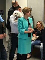 Oradell-based attorney Gina Calogero, who does work in pet custody disputes escorts Linda the dog, carried by Bloomfield resident Eric Saharig on Wednesday, Oct. 18, 2017.
