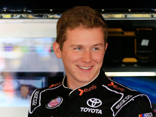Matt Tifft, driver of the #19 Toyota, stands in the