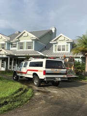 A Palm City fire threatened this two-story home Friday morning.