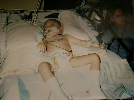 Dalton Sampson in the ICU at age 3 after surgery to