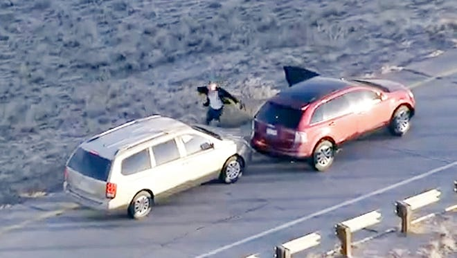 In this image taken from video provided by CBS-4 TV Denver, Ryan Stone abandons a stolen SUV, right, with a 4-year-old child inside and steals a car, left, during a high speed chase in the Denver metro area, Wednesday, March 12, 2014.