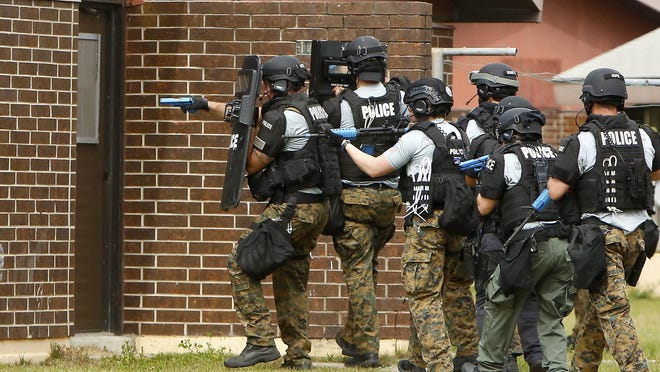 Officers with the Gainesville Police Department SWAT team do tactical training in closed houses in the Woodland Park neighborhood in 2019.