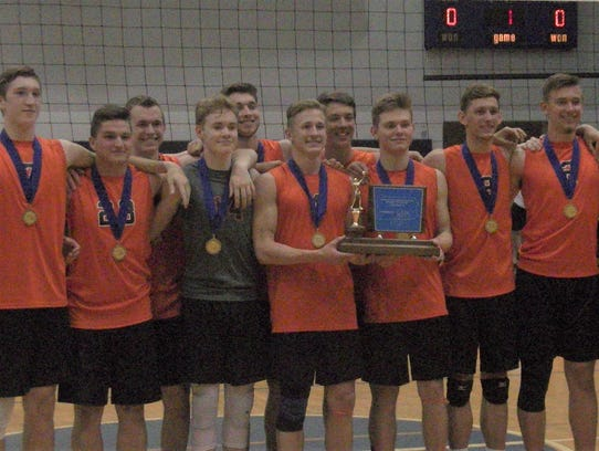Northeastern's boys' volleyball team poses with the
