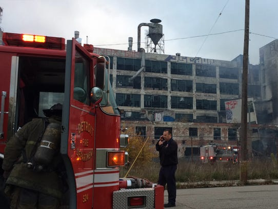 A Detroit firefighter was knocked unconscious this