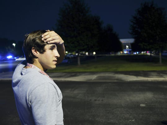 Theater goer Jacob Broussard said he was standing in line to go inside the Grand Theatre when a shooting occurred and police responded to the scene Thursday, July 23, 2015, in Lafayette, La. (Leslie Westbrook/The Advocate via AP)
