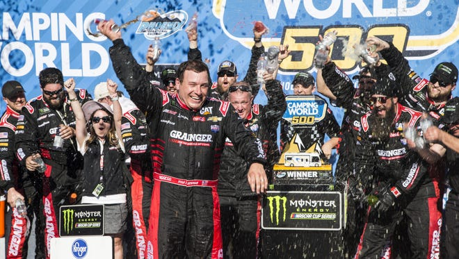 Ryan Newman celebrates with his team after winning the Camping World 500 at Phoenix International Raceway on March 19, 2017 in Avondale, Ariz.