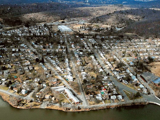Aerial photo of the Pompton Lakes neighborhood that sits above a plume of contaminated groundwater, with  the former DuPont munitions site in the background, taken in January 2010.