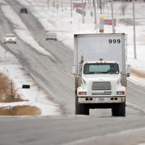 A large truck hauls freight Wednesday on Stearns County Road 2 near Cold Spring.