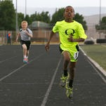 McKay Wells (pictured) and 11 other Utah athletes part of the Quickfeet Track Club left Sunday to compete in the 2015 Junior Olympics in Jacksonville, Florida.