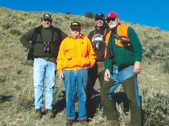 Green Bay hunters Steve Wagnitz, left, and Don Bins, Murray Basten and Dan Bins pose on a hillside in southeastern Montana in November 2016.