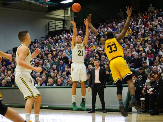 Vermont's Everett Duncan (21) shoots the ball during the men's basketball game between the UMBC Retrievers and the Vermont Catamounts at Patrick Gym in January.