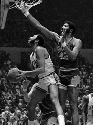 New York Knicks  Walt Frazier (10) goes up in forth period of game March 14, 1973 at New York's Madison Square Garden but finds no rool at all in the basket. Above is outsteretched hand of Phoenix Suns' Connie Hawkins (42) in the net. Knicks Willis Reed (19) is right.
