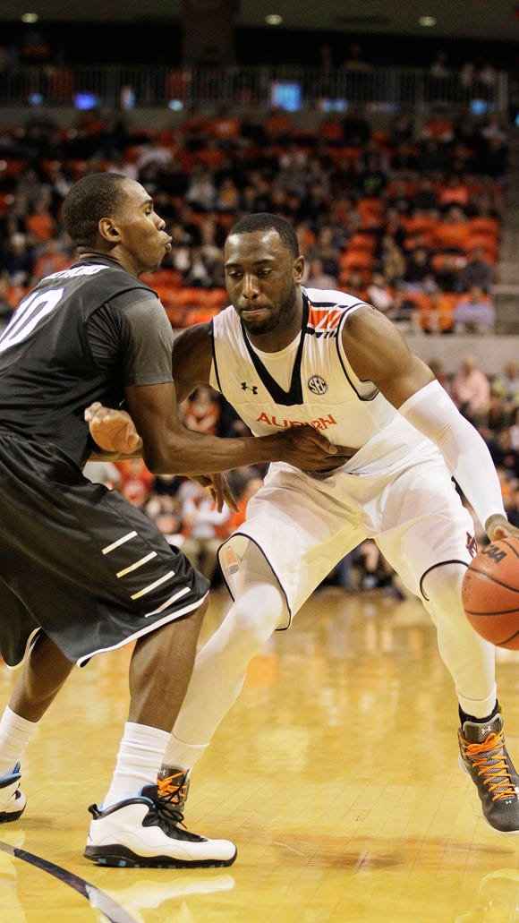 Dec 29, 2014; Auburn, AL, USA; Auburn Tigers guard Antoine Mason (14) is fouled by Middle Tennessee State Blue Raiders guard Jaqawn Raymond (10) during the second half at Auburn Arena. The Tigers beat the Blue Raiders 64-48. Mandatory Credit: John Reed-USA TODAY Sports