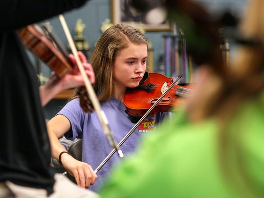 Emily Harris plays her violin during seventh-grade orchestra class at Southwood Academy of the Arts in Anderson.