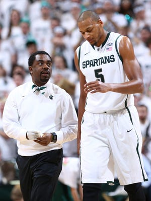 Michigan State trainer Quinton Sawyer has helped keep the Spartans, including Adreian Payne, on the court this season.
