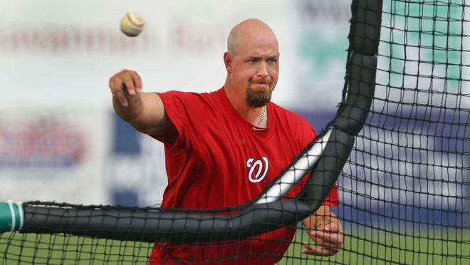Former big-league pitcher Tim Redding throws batting practice to the Auburn Doubledays prior to a recent game. Redding is in his first season as the Doubledays' pitching coach.