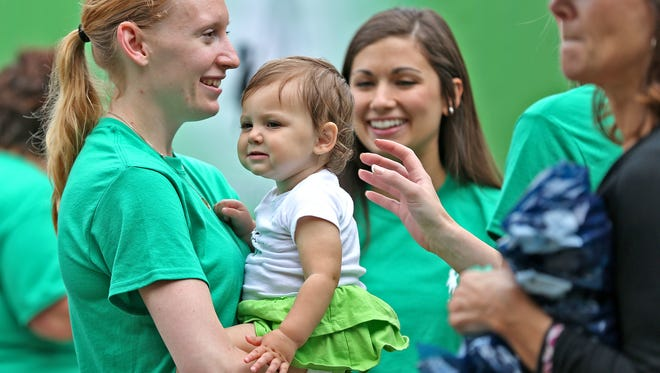 People talk with Jennifer Trapuzzano (left) and her daughter, Cecilia, before the Nate Walk starting from Edna Balz Lacy Family Park on Sunday, May 17, 2015.  The Nathan Trapuzzano Memorial Foundation hosted the walk to raise money for children who have lost a parent. Jennifer's husband, Cecilia's father, Nathan Trapuzzano, was shot to death in 2014.
