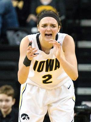 Iowa's Ally Disterhoft (2) rally her team in the second half of play during the second round of the NCAA Women's Basketball Championship at Carver-Hawkeye Arena in Iowa City on Sunday, March 22, 2015. The Hawkeyes beat the Hurricanes 88-70 to advance to the Sweet 16. (Justin Torner/Freelance for the Press-Citizen)