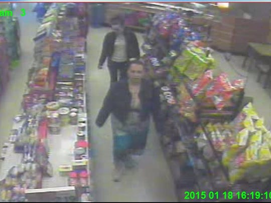 Screen capture of surveillance tape of two white females Staunton Police need held identifying in the connection to several incidents where counterfeit bills were passed.