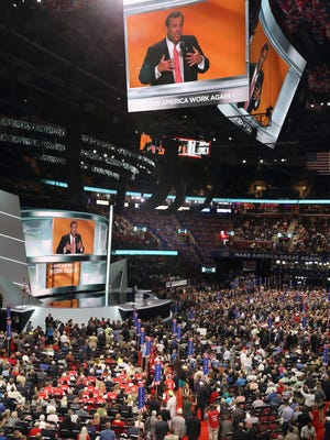 NJ Governor Chris Christie appears on screens as he speaks during the Republican National Convention at the Quicken Loans Arena in Cleveland Tuesday July 19, 2016.