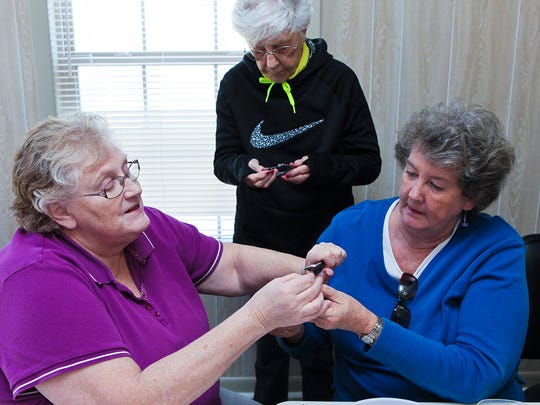 Dawn Patterson, left, Marlou Patterson, center, and Sheila Fleming work on crafts at Smyrna Senior Center.