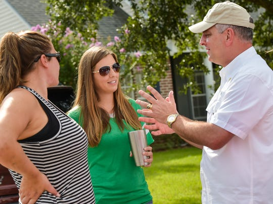 Gov. John Bel Edwards visits with neighborhoods damaged by flood waters. (Pictured L-R, Jessica Venable, Nicole Sylvester and Gov Edwards) August 25, 2016.