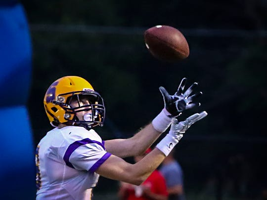 Smyrna's Mason Cunningham hauls in a TD pass during