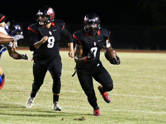 Stewarts Creek running back Zach Long looks downfield as Nathan Wright (8) blocks during a game against La Vergne this season.