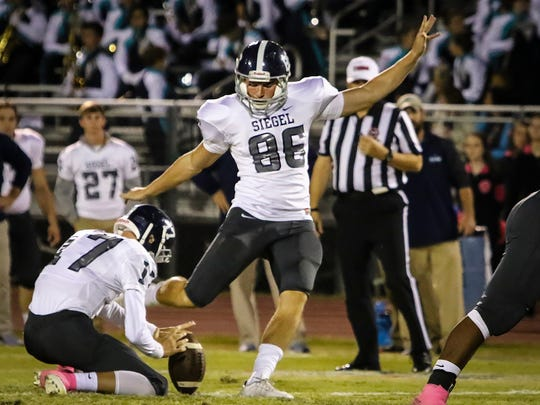 Siegel's Jacob Smith drills a 55-yard field goal during a 2016 game.