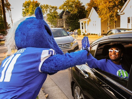 Lightning, MTSU's mascot, high fives a fan in the Homecoming parade Saturday, Oct. 15, 2016, in Murfreesboro. The parade started at 9:30 a.m. and wound through downtown Murfreesboro on East Main Street, across Middle Tennessee Boulevard and onto Baird Lane.