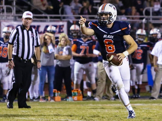 Blackman QB Conner Mitchell directs traffic during Friday's win over Warren County.