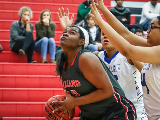 Oakland's Correna Ellis looks for a shot in the paint
